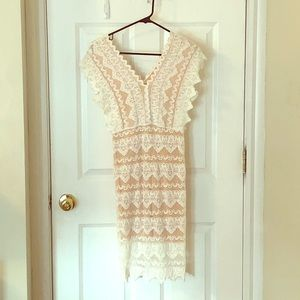 White lace dress with nude underlay